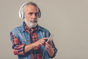 OTvest-Agitation-Older_man_with_headphones_and_vest