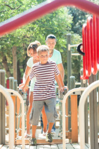 OTvest-Alternative_medication-boy_and_family_at_playground