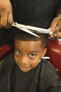 OTvest-Boy_smiling_for_haircut