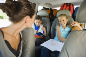 OTvest-adhd-Mother_looking_at_kids_in_back_seat