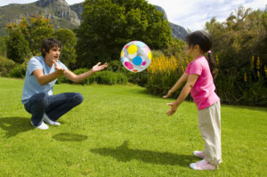 OTvest-father_and_daughter_playing_ball