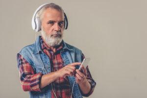 OTvest-Agitation-Older_man_with_headphones_and_vest