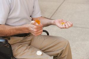 OTvest-Alternative_Medication-man_holding_mediciation
