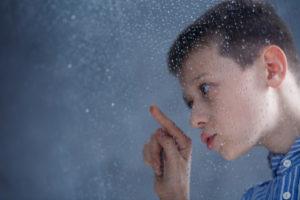 OTvest-Autistic_boy_raindrops_at_window