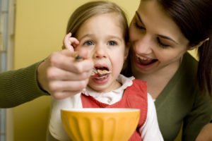 OTvest-Mom_feeding_daughter